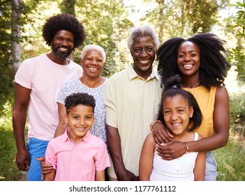 Multi generation black family in a forest, close up portrait
