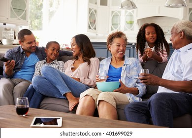 Multi generation black family talking together while watching TV