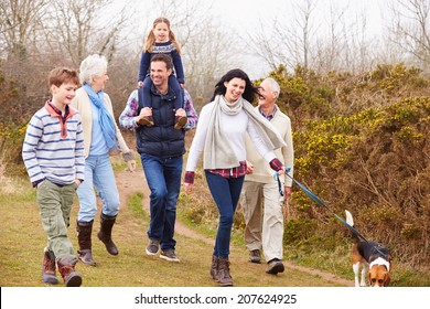 Multi Generation Family With Dog On Countryside Walk