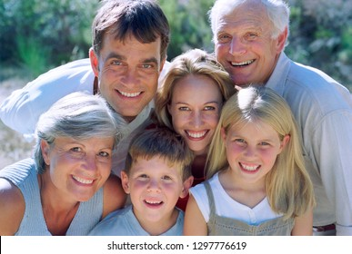 Multi generation family son walk in countryside smiling at camera