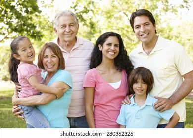 Multi Generation Hispanic Family Walking In Park