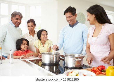 Multi Generation Indian Family Cooking Meal At Home