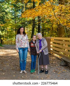 A multi generation portrait of a happy grandmother with her daughter and granddaughter outdoor