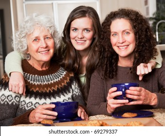 A multi generation portrait of a happy grandmother with her daughter and granddaughter spending time together