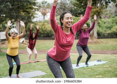 Multi generational people doing yoga class keeping at city park - Focus on center girl face
