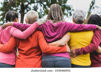 Multi generational women hugging each other outdoor - Multiracial people and teamwork concept