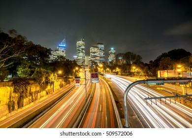 Multi lane cross city highway in Sydney, Australia, from above towards city CBD.