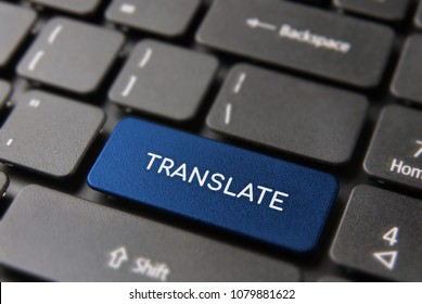 Multi language translation concept, computer keyboard with translate text on color keypad button.