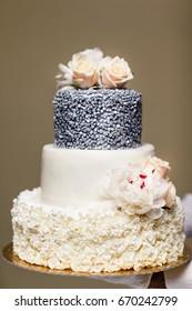 Multi level wedding cake with flowers.