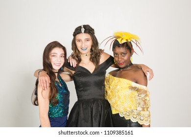 Multi racial diversity with a vintage look three girls with fashion couture posing on a white background