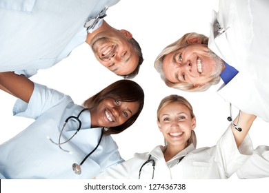 Multi racial group or happy doctors looking down smiling at the camera - Isolated on white