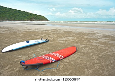Multi Surfboard on clear sand beach with copy space for content