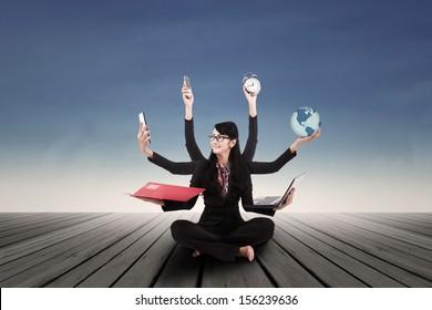 Multi tasking Asian businesswoman