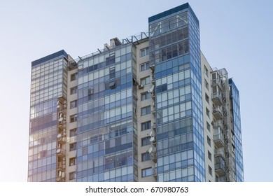 Multi-apartment residential complex with windows against the blue sky. Building construction
