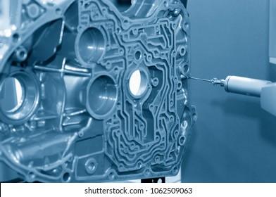 The multi-axis CMM machine measure the aluminum automotive part .