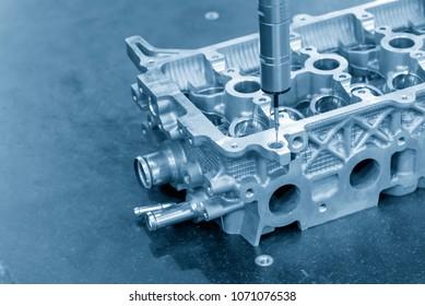 The multi-axis CMM machine measure the aluminum automotive part .The automotive part quality control concept.