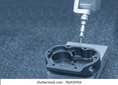 The multi-axis CMM machine measure the aluminum part in the light blue scene.Quality control processing for industrial.