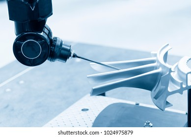 The multi-axis coordinate Measuring Machine, CMM probe measures the work piece.