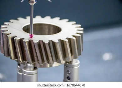 The multi-axis,CMM touch probe  measure dimension of the transmission bevel gear parts. The quality control in automotive  parts manufacturing process by multi-axis CMM machine.