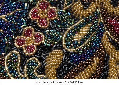 Multi-beaded background. vintage patterns flowers. Place for text.