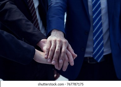 multibusiness shake hands showing Trustworthy team work .Managing small businesses with incentives to work as a system incorporating a strong network. ,multiethnic people working togetherness.