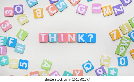 Multi-color Alphabet ABC letters and number and mathematics sign in square flat papers on white background with THINK at center.