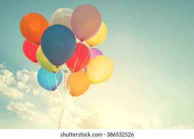 multicolor balloons with a retro instagram filter effect, concept of happy birthday in summer and wedding honeymoon party (Vintage color tone)