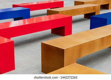 Multicolor benches in the city. Benches made of lumber, plywood. Design solution for a recreation area in the park.Benches made from plywood sheets do-it-yourself (handmade)