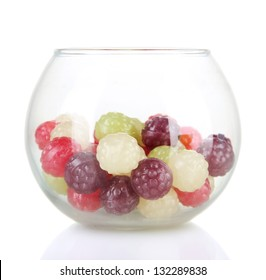 Multicolor candies in glass bowl, isolated on white