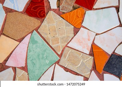Multicolor ceramic mosaic floor. Creative recycled mosaic top view photo. Bathroom or kitchen floor design idea. Blue yellow ceramic tiles. Reused broken tile. Pottery texture. Colored eastern pottery