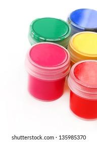 multicolor children paints on white background