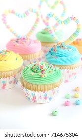 Multicolor cupcakes group with candy heart toppers