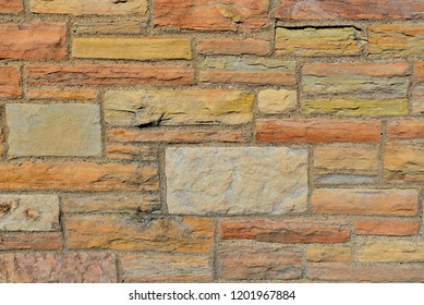 Multicolor and different size brick wall pattern or texture.
