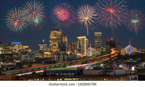 Multicolor Firework Celebration over Scene of Boston skyline which can see Zakim Bridge and Tobin Bridge with express way over the Boston Cityscape, 4th of July and Independence day concept