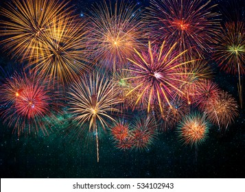 Multicolor Firework Celebration over the soft focus of milky way background