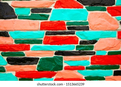 Multicolor green and red brick wall background