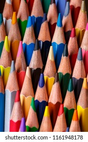 Multicolor group of cute wooden pencils. Drawing with pencils. 1 September concept postcard, teachers day. Abstract background from color pencils