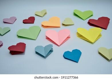 Multicolor heart-shaped origami on desk. Closeup