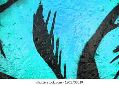 Multicolor iris, cyan and lagoon surface. Kids drawing on the wall surface. Ornament and decoration for holidays.