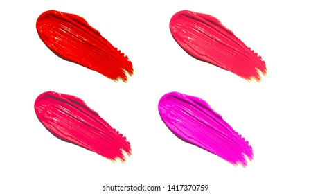 Multicolor liquid lipstick smudges isolated on white background. Lip gloss and lipstick smears. Makeup swatches. Cosmetic product strokes. Lipstick, makeup product swatch.