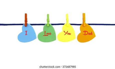 Multi-color love shapes with text I LOVE YOU DAD clipped mini multi-color wooden clip on blue rope isolated on white background