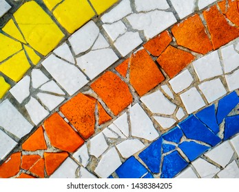 Multicolor mosaic wall decorative ornament from ceramic broken tile. Strip, line.