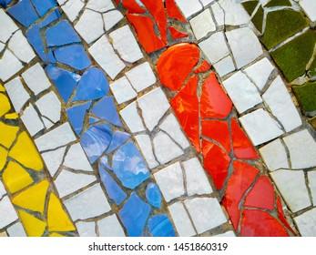 Multicolor mosaic wall decorative ornament from ceramic broken tile. Strip, line, copy space.