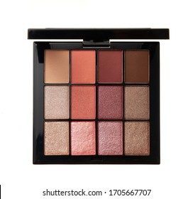 Multicolor palette of trendy shades of eyeshadow isolated on white background.