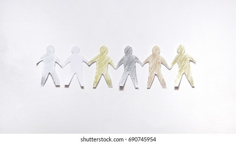 Multicolor paper craft people holding hands