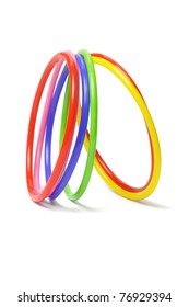 multicolor plastic bangles arranged on white background