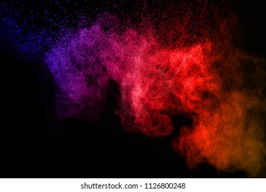 Multicolor powder explosion on black background. Paint Holi.Colored cloud. Colorful dust explode.