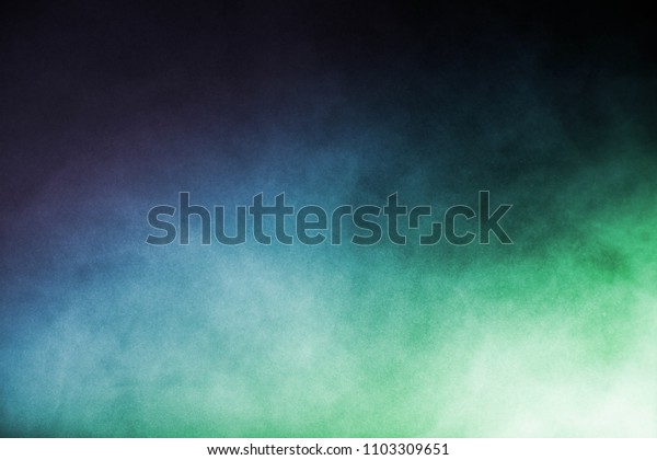 Multicolor powder explosion on black background. Colored cloud. Colorful dust explode.