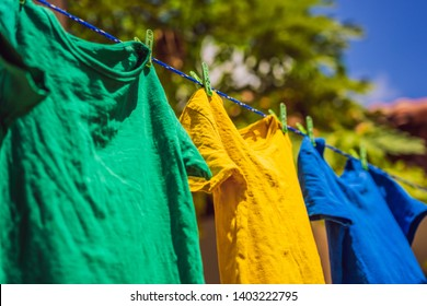 Multicolor shirts on clothesline in sunny day