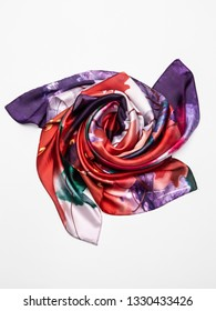 Multicolor silk scarf on white background. Top view.